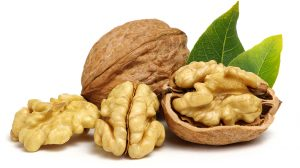 walnuts in and out of shell with leaves